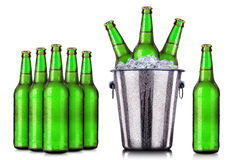 Set of beer's bottles with frosty drops in ice royalty free stock photo