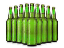 Set of beer's bottles with frosty drops isolated Royalty Free Stock Photo