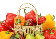 Set bell peppers in a basket on a white background Royalty Free Stock Photography