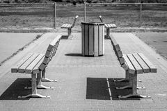 Benches in a park. A set of 4 benches on a brick walkway in a park Royalty Free Stock Photography
