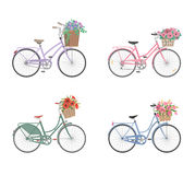 Set of bicycles with basket full of flowers Stock Images