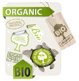 Set of bio, eco, organic elements. Labels, stickers, stamps, ribbons on sheet of paper Royalty Free Stock Images