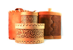 A set of birch bark boxes with lids on white background. Stock Photos