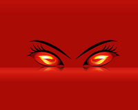 Fiery eyes on red background Stock Photo