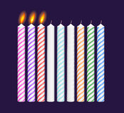 Set of birthday multicolored candles. New, burning Stock Image