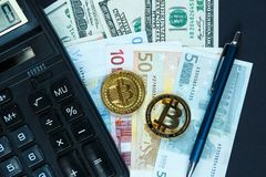 Set of bitcoin, crypto currency with yellow paper arrows next to notepad on real money background. Time is money. Internet e-commerce, security, risk stock photo