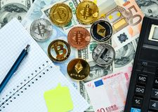 Set of bitcoin, ethereum - crypto currency next to notepad on real money background. Time is money. Internet e-commerce, security. Risk, investment, business stock photography