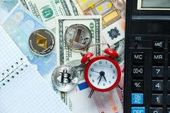 Set of bitcoin, ethereum - crypto currency next to notepad on real money background. Time is money. Internet e-commerce, security. Risk, investment, business royalty free stock images