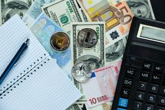 Set of bitcoin, ethereum - crypto currency next to notepad on real money background. Time is money. Internet e-commerce, security. Risk, investment, business royalty free stock image
