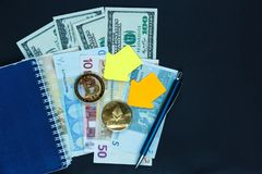Set of bitcoin, ethereum - crypto currency with yellow paper arrows next to notepad on real money background. Time is money. Internet e-commerce, security royalty free stock photo