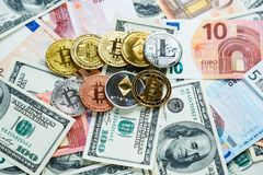 Set of bitcoin, litcoin, ethereum - crypto currency on real money background. Internet e commerce, security, risk, investment. Business concept stock photos