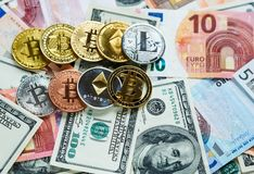Set of bitcoin, litcoin, ethereum - crypto currency on real money background. Internet security, risk, investment, business. Concept stock photo