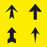 Set of black arrows on a yellow background. Vector illustration Stock Images