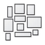 Set of Black Blank Picture Frames, hanging on a White Wall from Stock Image