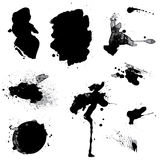 Set of black blots and ink splashes isolated on white background. Abstract elements for design in grunge style Stock Illustration