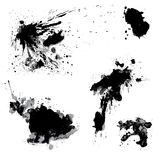 Set of black blots and ink splashes isolated on white background. Abstract elements for design in grunge style Royalty Free Illustration