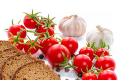 Set of black bread, tomatoes and garlic. Composition of black bread,  tomatoes and garlic Stock Photo