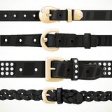 Set of black buttoned to buckle belts Royalty Free Stock Images