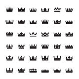 Set of black  crowns and icons Stock Photos