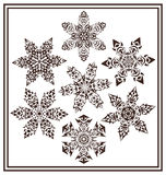 Set of 7 black elegant geometric winter snowflake shapes Royalty Free Stock Photography