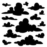 Set of black fluffy clouds silhouettes on white background. Illustration in flat cartoon style. Elements for your design. Set of black fluffy clouds silhouettes Stock Image