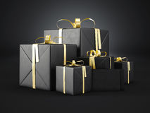 Set of black gift boxes Of various sizes with golden ribbon bow and blank envelope on dark background. 3d render Royalty Free Stock Photography