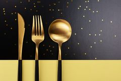 Set of black and gold cutlery royalty free stock photography
