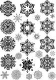 Set of black and gray snowflakes Stock Images