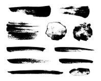 Set of black grunge vector brushes Stock Photography