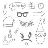 Set of black hand drawn christmas doodle icons for your designs poster, card, invitations and greeting cards.  Stock Image