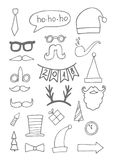 Set of black hand drawn christmas doodle icons for your designs poster, card, invitations and greeting cards.  Stock Photography