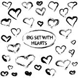 Set with black hand drawn hearts in grunge style. Vector illustration.  Royalty Free Illustration