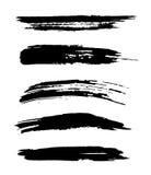 Set of  black hand painted brush strokes  on white. Background Royalty Free Stock Image