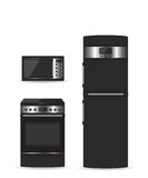 Set of black household appliances Microwave refrigerator and stove Royalty Free Stock Photos