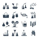 Set of black icons chemical laboratory equipment. And test-tubes Stock Images