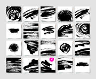 Set of 20 black ink brushes grunge square pattern Royalty Free Stock Photos