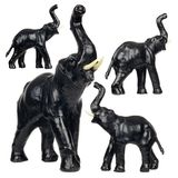 Set of Black Leather Elephant Figurines Royalty Free Stock Photos