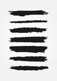 Set of black lines painted rough brushes. Grunge strokes. Royalty Free Stock Photos