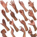 Set of black male hands showing symbols. African-american man hands showing symbols and gestures, like, offering, ok, writing, isolated on white background. Set Royalty Free Stock Images