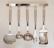 Set of black modern kitchen utensil hanging Stock Image