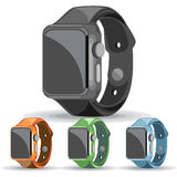 A set of black, orange, green and blue smart watches Stock Image