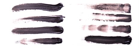 Set of black paint or mascara strokes isolated on white background. stock photo