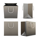 Set of black paper shopping bags from different angles. 3d. Royalty Free Stock Photos