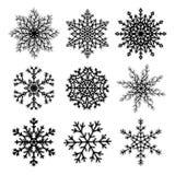 Set of black paper snowflakes Stock Photos