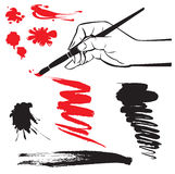 Set of black and red blots and hand with brush on stock illustration