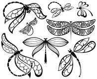 Set of black silhouettes dragonflies. Set of flying dragonflies on white Royalty Free Illustration
