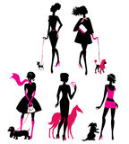Set of black silhouettes of fashionable girls with their pets. Dogs (dachshund, terrier, poodle, chihuahua) on a white background royalty free illustration
