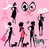 Set of black silhouettes of fashionable girls with their pets. Dogs (Dalmatian, terrier, poodle, chihuahua) on a pink background royalty free illustration