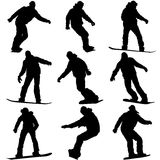 Set black silhouettes snowboarders on white background. Vector Royalty Free Stock Photo