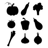 Set of black silhouettes of vegetables. Vector illustration. Royalty Free Stock Images